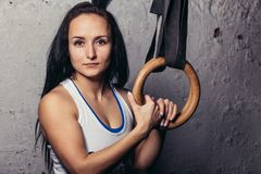 Portrait Of A Fitness woMan Training Arms With Gymnastics Rings In The Gym Royalty Free Stock Image