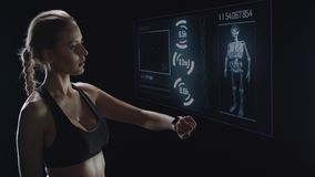 Portrait of fitness woman checking pulse with smart watch after workout.