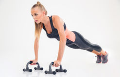 Portrait of a fitness woman doing push ups Stock Images
