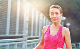 Portrait of fitness woman listening music Stock Photos