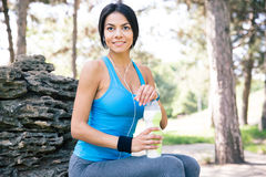 Portrait of a fitness woman resting outdoors Royalty Free Stock Photos