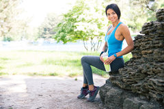 Portrait of a fitness woman resting outdoors Royalty Free Stock Photo