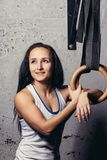 Fitness woMan Training Arms With Gymnastics Rings In The Gym Stock Photography
