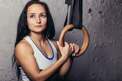 Fitness woMan Training Arms With Gymnastics Rings In The Gym Royalty Free Stock Photo