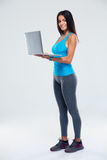 Portrait of a fitness woman using laptop Stock Photos