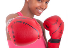 Portrait of a fitness woman wearing boxing gloves Stock Images