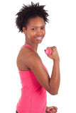 Portrait of a fitness woman working out with free weights Royalty Free Stock Photos