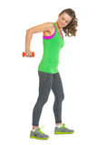 Portrait of fitness young woman making exercise with dumbbells Royalty Free Stock Images