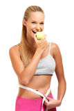 Portrait of a fitt woman with apple Stock Photos