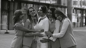Portrait of five business women outdoors. Portrait of five attractive business women near business centre. Summer day. Black and white version color and no stock video