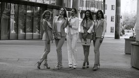 Portrait of five business women outdoors. Portrait of five attractive business women posing near business centre. Summer day. Black and white version color and stock footage