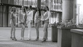 Portrait of five business women outdoors. Portrait of five attractive business women posing near business centre. Summer day. Black and white version color and stock video