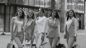 Portrait of five business women outdoors. Portrait of five attractive business women standing near business centre. Summer day. Black and white version color and stock video