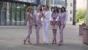 Portrait of five business women outdoors. Portrait of five attractive business women posing near business centre. Summer day. Color grading version black and stock video