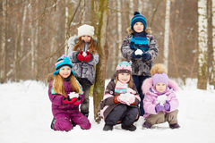 Portrait of five children who hold snowballs stock photo