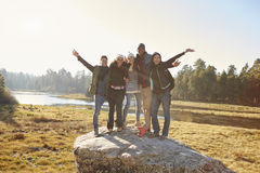 Portrait of five friends standing on a rock in countryside Royalty Free Stock Photo