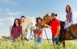 Portrait of five happy young horseback riders Stock Images