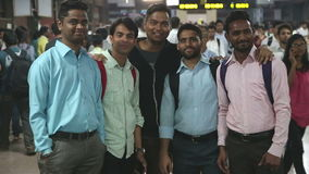 Portrait of five Indian men at a crowded train station in Mumbai. MUMBAI, INDIA - 8 JANUARY 2015: Portrait of five Indian men at a crowded train station in stock video footage