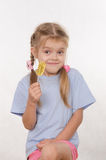 Portrait of five year girl with lollipop in her hand Stock Photography
