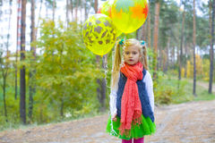Portrait of five-year-old girl with balloons Royalty Free Stock Photo
