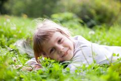 Portrait of    girl in  grass. Portrait of five year old girl in green grass royalty free stock photo