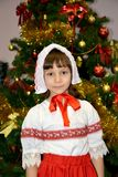 Portrait of the five-year-old girl in a suit of the Little Red Riding Hood about a New Year tree Royalty Free Stock Images