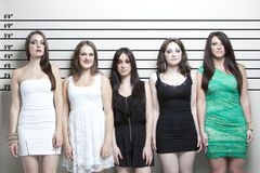 Portrait of five young women in a police lineup Royalty Free Stock Photography