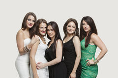 Portrait of five young women posing together over gray background Stock Image