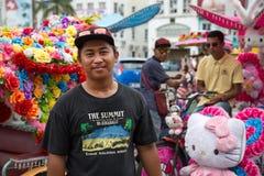 Portrait of an flamboyant rickshaw man, Malacca Royalty Free Stock Image