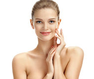 Portrait flawless woman isolated on white background. Close-up of smiling young woman with perfect skin. Skin care concept Royalty Free Stock Photos
