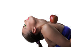 Portrait of flexible young girl posing with apple Stock Images