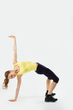 Portrait of a flexible young yoga girl in yelow top Stock Image