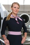 Portrait of the flight attendant standing Stock Photo