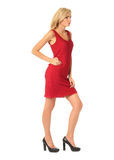 Portrait of flirtatious woman in red cocktail dress isolated on Royalty Free Stock Photo