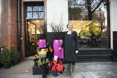 Portrait of florist standing in front of her shop Royalty Free Stock Photos