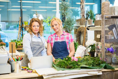 Portrait Of Florists With Laptop In Flower Shop Royalty Free Stock Photos
