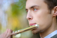 Portrait of a flutist Royalty Free Stock Images