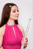Portrait of flutist woman in red dress with flute Royalty Free Stock Images