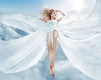 Portrait of a flying blond nymph. Portrait of a pretty flying blond nymph Royalty Free Stock Image