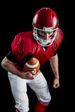 Portrait of focused american football player being ready to attack Stock Photography