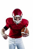 Portrait of focused american football player being ready to attack Royalty Free Stock Image