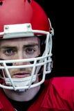 Portrait of focused american football player wearing his helmet Royalty Free Stock Images