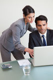 Portrait of a focused business team working with a laptop Stock Image