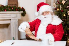 Santa claus reading wish list stock images