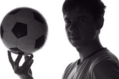 Portrait of a football player with the ball royalty free stock image