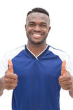 Portrait of a football player gesturing thumbs up Stock Image
