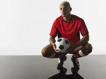 Portrait Of Football Player Squatting Royalty Free Stock Photography