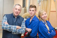 Portrait foreman with two apprentices. Portrait of foreman with two apprentices royalty free stock photo