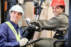 Portrait Of Forklift Driver With Supervisor Stock Images