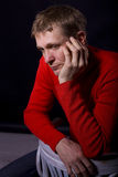 Portrait of forty-year-old man on a black background. Studio portrait of the thoughtful forty-year-old man on a black background Stock Photos